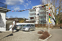 "Switzerland. Canton Aargau. Brugg. Yangchen Büchli and her husband Thomas near their showroom ""Pema of Tibet"". Lung ta are tibetan prayer flags of square or rectangular shape, and are connected along their top edges to a long string or thread. The swiss tibetan woman is an Aeschimann's child who arrived 50 years ago in Switzerland to receive custody on a private initiative by an influential Swiss industrialist, Charles Aeschimann. In 1962, Charles Aeschimann agreed with the Dalai Lama to take 200 children and place them in Swiss foster homes and give them a chance for a better life and a good education. Most of the children still had parents in exile or in Tibet, just a few were orphans. 25.02.2015 © 2015 Didier Ruef"