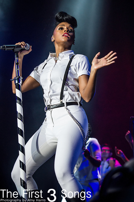 Janelle Monae performs at the 2013 Essence Festival at the Mercedes-Benz Superdome in New Orleans, Louisiana.