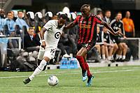ATLANTA, Georgia - August 27: Romain Métanire #19 and Florentin Pogba #4 during the 2019 U.S. Open Cup Final between Atlanta United and Minnesota United at Mercedes-Benz Stadium on August 27, 2019 in Atlanta, Georgia.