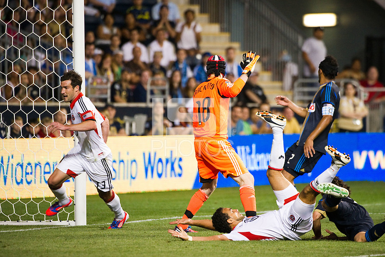 Chris Pontius (13) of DC United celebrates scoring during the second half against the Philadelphia Union . DC United defeated Philadelphia Union 1-0 during a Major League Soccer (MLS) match at PPL Park in Chester, PA, on June 16, 2012.