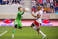 CD Chivas USA goalkeeper Dan Kennedy (1) takes the ball away from an onrushing Thierry Henry (14) of the New York Red Bulls during the first half  of a Major League Soccer (MLS) match at Red Bull Arena in Harrison, NJ, on May 23, 2012.