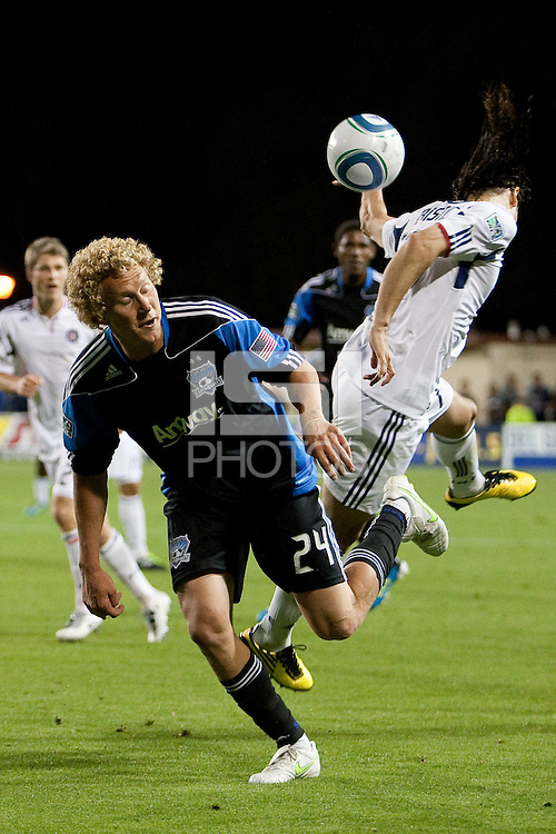 Steven Lenhart (24) goes for the header against Bratislav Ristic. The Chicago Fire defeated the San Jose Earthquakes after going 5-4 on penalty kicks, after a 2-2 score in regulation during the US Open Cup at Buck Shaw Stadium in Santa Clara, California on May 24th, 2011.