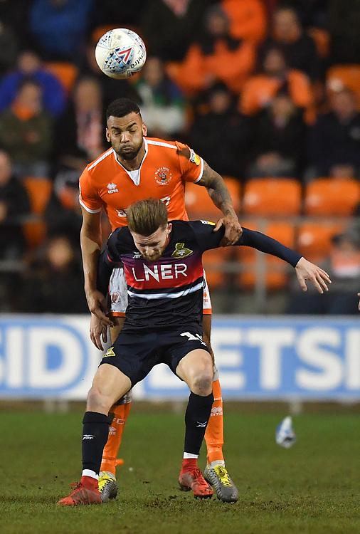Blackpool's Curtis Tilt out jumps Doncaster Rovers' Alfie May<br /> <br /> Photographer Dave Howarth/CameraSport<br /> <br /> The EFL Sky Bet League One - Blackpool v Doncaster Rovers - Tuesday 12th March 2019 - Bloomfield Road - Blackpool<br /> <br /> World Copyright © 2019 CameraSport. All rights reserved. 43 Linden Ave. Countesthorpe. Leicester. England. LE8 5PG - Tel: +44 (0) 116 277 4147 - admin@camerasport.com - www.camerasport.com