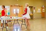 The Sun City Poms rehearse in a recreation hall for an upcoming holiday performance in nearby Glendale, Arizona. The cheerleading squad members range from 57 to 81 years old.