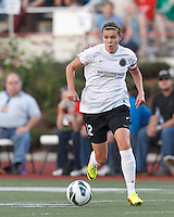 Portland Thorns FC forward Christine Sinclair (12) on the attack.  In a National Women's Soccer League (NWSL) match, Boston Breakers (blue) defeated Portland Thorns FC (white/black), 2-1, at Dilboy Stadium on August 7, 2013.