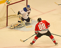 Patrick  Kane breaks in for a first period goal