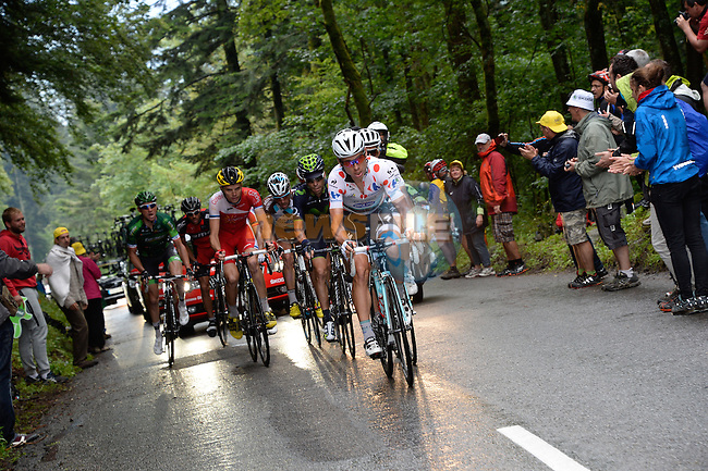 Tony Martin (GER) brings Omega Pharma-Qiuck Step team mate Michal Kwiatkowski (POL) up to the breakaway group of Giovanni Visconti (ITA) Movistar, Christophe Riblon (FRA) AG2R, Rein Taaramae (EST) Cofidis, Thomas Voeckler (FRA) Europcar and Amael Moinard (FRA) BMC during Stage 10 of the 2014 Tour de France running 161.5km from Mulhouse to La Planche des Bellles Filles. 14th July 2014.<br /> Photo ASO/B.Bade/www.newsfile.ie