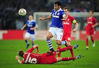 FUSSBALL   EUROPA LEAGUE   SAISON 2011/2012  ACHTELFINALE FC Schalke 04 - Twente Enschede                         15.03.2012 Rasmus Bengtsson (am Boden, Enschede) gegen Raul (FC Schalke 04)