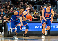 WASHINGTON, DC - DECEMBER 28: Sa'eed Nelson #0 and Ben Lubarsky #30 of American on the attack. during a game between American University and Georgetown University at Capital One Arena on December 28, 2019 in Washington, DC.