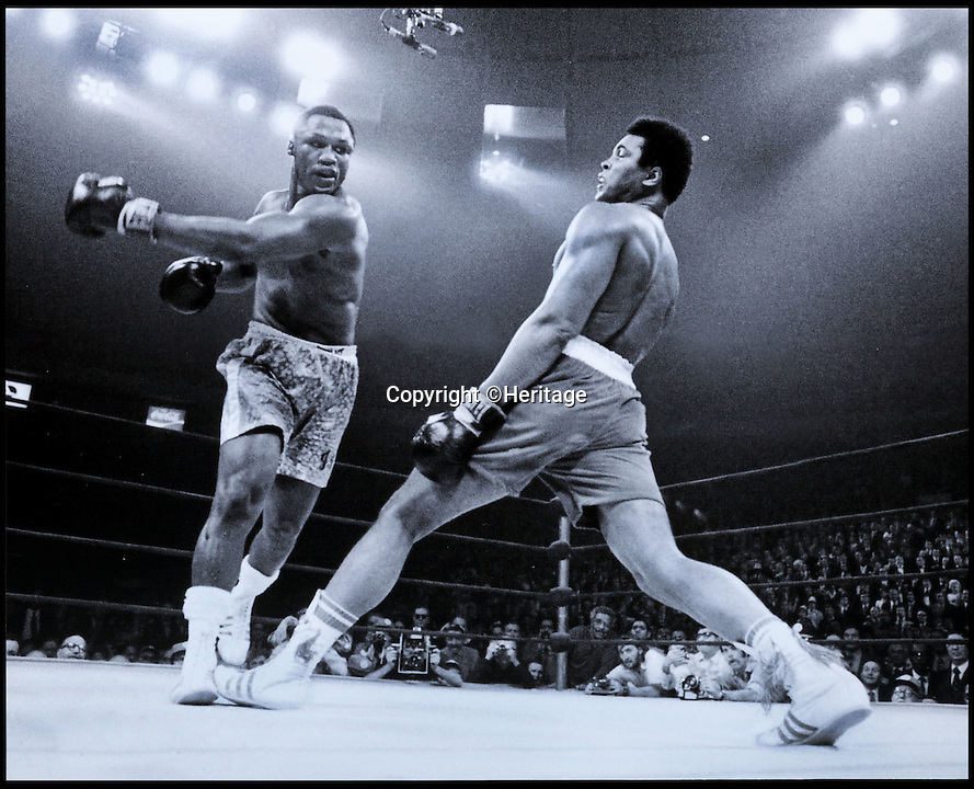 BNPS.co.uk (01202 558833)<br /> Pic: Heritage/BNPS<br /> <br /> ***Use Full Byline***<br /> <br /> A photo taken during the fight in 1971.<br /> <br /> The boxing gloves worn by Muhammad Ali in his first ever professional defeat at the hands of arch-rival 'Smokin' Joe' Frazier have emerged for sale for 300,000 pounds.<br /> <br /> The gloves were used by the boxing hero when he took to the ring against Frazier in March 1971 in a bout billed as the 'Fight of the Century'.<br /> <br /> Frazier was the most intimidating fighter at the time and the match, in New York's Madison Square Garden on March 8, 1971, was one of the most anticipated in the sport's history.<br /> <br /> The fight resulted in Ali's first ever professional loss and set the stage for a thrilling rematch against Frazier in New York in 1974 and the series decider, the Thrilla in Manilla, the following year, both of which Ali won.<br /> <br /> Experts have tipped them to fetch upwards of 300,000 pounds when they go under the hammer in the Heritage Auctions sale in Cleveland, Ohio, on July 31.<br /> <br /> And they could challenge the current world record for boxing memorabilia set in February this year when a pair of Ali's gloves from his 1964 heavyweight victory against Sonny Liston sold for 540,000 pounds.
