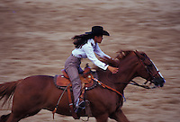 Young girl barrel racing at the Waimanalo Rodeo, windward Oahu, Hawaii