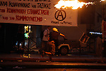 Anti-austerity protesters throw petrol bombs at riot police officers during clashes in the center of Athens. Greece's prime minister was fighting to keep his government intact in the face of outrage over an austerity bill that parliament must pass Wednesday night if the country is to start negotiations on a new bailout and avoid financial collapse. The raft of consumer tax increases and pension reforms will condemn Greeks to years of more economic hardship and has fueled anger among the governing left-wing Syriza party.