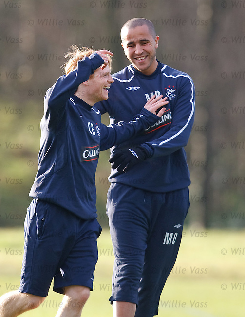 Madjid Bougherra embraces Chris Burke after beating the wee man in a sprint contest