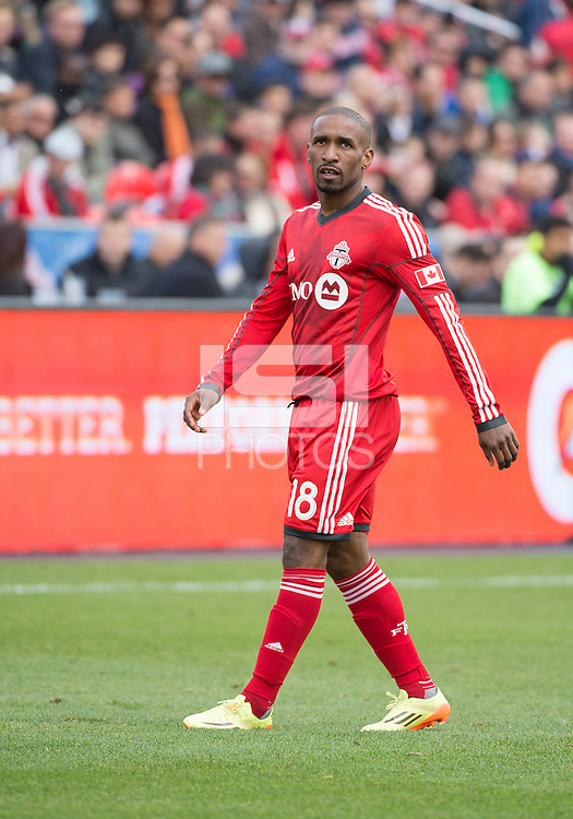 Toronto, Ontario - May 17, 2014: Toronto FC forward Jermain Defoe #18 in action during a game between the New York Red Bulls and Toronto FC at BMO Field. Toronto FC won 2-0.