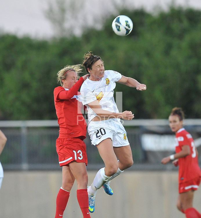 Abby Wambach (20)  of The Western New York Flash heads the ball against Julia Roberts (13) of the Washington Spirit.  The Washington Spirit tied The Western New York 1-1 in the home opener of The National Women's Soccer League, at Maryland SoccerPlex, Saturday April 20, 2013.