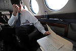 Beleaguered Illinois Governor Rod Blagojevich glances over at his notes for his speech in the state airplane on his way to speak in his own defense at his impeachment hearing at the state capitol in Springfield, Illinois as he flies from Chicago, Illinois on January 29, 2009.