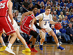 BROOKINGS, SD - FEBRUARY 23: Baylor Scheierman #3 of the South Dakota State Jackrabbits drives past Stanley Umude #0 of the South Dakota Coyotes Sunday at Frost Arena in Brookings, SD. (Photo by Dave Eggen/Inertia)