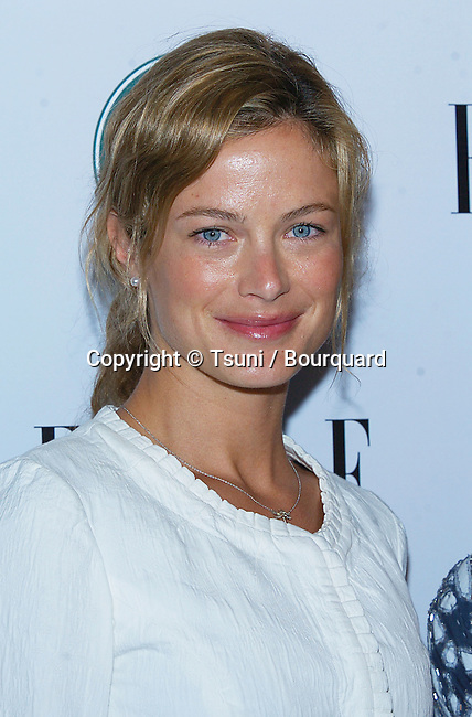 Carolyn Murphy arriving at the Global Green Premiere Issue at the PDC in Los Angeles.. April 5, 2006.