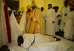 Halibethian Church,'based upon the principles of Christ', members of the congregation prostrating themselves  during the enthronement of Bishop Barrington Young. Harlesden north west London.