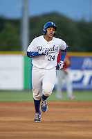 Xavier Fernandez (34) of the Burlington Royals rounds the bases after hitting a home run against the Johnson City Cardinals at Burlington Athletic Park on August 22, 2015 in Burlington, North Carolina.  The Cardinals defeated the Royals 9-3. (Brian Westerholt/Four Seam Images)
