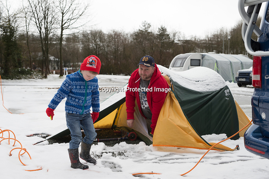 "28/03/16 <br /> <br /> Chris McCoy and son Joe McCoy (4) wake to a snow-covered tent.<br /> <br /> Holiday makers camping in the Derbyshire Peak District woke up to an unexpected white blanket this morning, thanks to Storm Katie.<br /> The covering of snow meant that many campers cut short their plans for a long weekend away, to brave the icy roads and head home early on Monday morning.<br /> But it wasn't all bad news for some of the younger guests at Grin Low Caravan Site in Buxton.<br /> Three-year-old Greta Williams made the most of the morning's surprise by building a snowman and enjoying snowball fights with her aunt Claire Jones. <br /> Claire said it was the first time she had been camping in the snow. <br /> ""It was completely unexpected but it's made it a trip to remember,""she said. <br /> ""Greta really enjoyed making the snowman, but I think we'll head back home now in case any more falls.""<br /> For Chris and Lorraine McCoy the first they knew of the snow was when they woke up and stuck their heads out of their tent.<br /> They had travelled to Buxton from Warwickshire with their four-year-old son Joe, to enjoy a weekend break.<br /> ""It's all part of the adventure,"" said Chris. ""It's a bit cold in the tent but we'll soon warm up, and it's made the surrounding countryside really beautiful.""<br /> <br /> All Rights Reserved: F Stop Press Ltd. +44(0)1335 418365   +44 (0)7765 242650 www.fstoppress.com"
