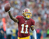 Washington Redskins wide receiver DeSean Jackson (11) celebrates after catching a 69 yard touchdown pass against the Dallas Cowboys in the first quarter at FedEx Field in Landover, Maryland on Sunday, December 28, 2014.  <br /> Credit: Ron Sachs / CNP