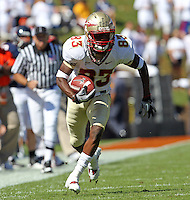 Oct 2, 2010; Charlottesville, VA, USA; Florida State Seminoles wide receiver Bert Reed (83) runs with the ball during the game against the Virginia Cavaliers at Scott Stadium. Florida State won 34-14.  Mandatory Credit: Andrew Shurtleff-