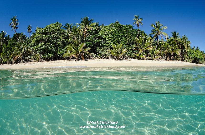 Over-under view of an idyllic beach at Teaupa island, Kotu group, Ha'apai, Tonga, Pacific Ocean