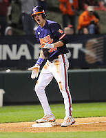 Center fielder Will Lamb (30) of the Clemson Tigers shouts after hitting a triple to score a run in the ninth inning of a game against the South Carolina Gamecocks on Tuesday, March 8, 2011, at Fluor Field in Greenville, S.C.  South Carolina won, 5-4.  Photo by Tom Priddy / Four Seam Images