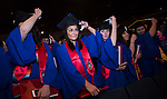 Students flip their tassels after receiving their degrees Saturday, June 10, 2017, during the DePaul University College of Education commencement ceremony at the Rosemont Theatre in Rosemont, IL. (DePaul University/Jeff Carrion)