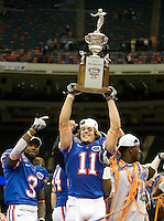 01 January 2010:  Riley Cooper of Florida holds up Sugar Bowl Champion trophy after winning the game against Cincinnati during Sugar Bowl at the SuperDome in New Orleans, Louisiana.  Florida defeated Cincinnati, 51-24.