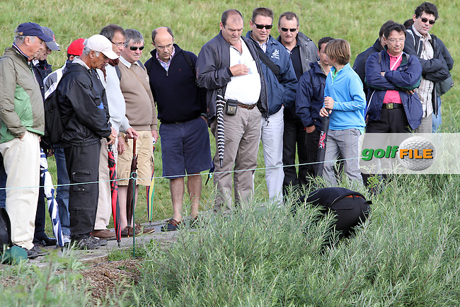 Joost Luiten (NED) looks for his ball after hitting his second shot into the bushes on the 1st on Day 4 of the Alstom Open de France at Golf National,  Saint-Quentin-En-Yvelines, Paris, France, 8/7/12...(Photo Jenny Matthews/www.golffile.ie)