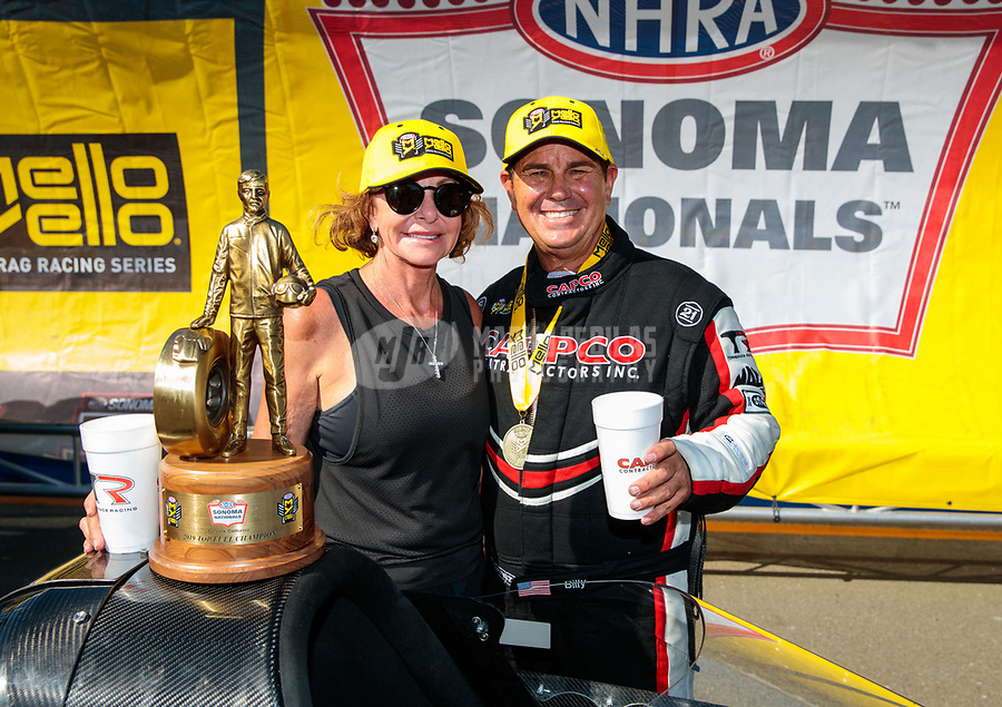 Jul 28, 2019; Sonoma, CA, USA; NHRA top fuel driver Billy Torrence celebrates with wife Kay Torrence after winning the Sonoma Nationals at Sonoma Raceway. Mandatory Credit: Mark J. Rebilas-USA TODAY Sports