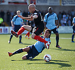 Nicky Law vaults the tackle of James Dale