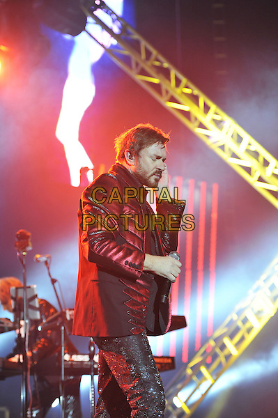 Simon Le Bon.Duran Duran performing live in concert, O2 Arena, Greenwich, London, England. 12th December 2011.on stage gig performance music half length suit red maroon burgundy suit jacket beard facial hair  side profile  .CAP/MAR.© Martin Harris/Capital Pictures.