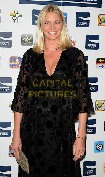 JODIE KIDD .At the Carphone Warehouse Appys Awards, Vinopolis, Stoney Street, London, England, UK, April 11th 2011..half  length black dress pregnant maternity patterned gold clutch bag  cleavage .CAP/CAN.©Can Nguyen/Capital Pictures.