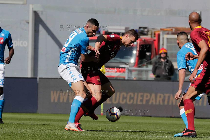 Nikola Maksimovic of Napoli and Edin Dzeko of AS Roma  during the  italian serie a soccer match, AS Roma -  SSC Napoli       at  the Stadio Olimpico in Rome  Italy , March 31, 2019
