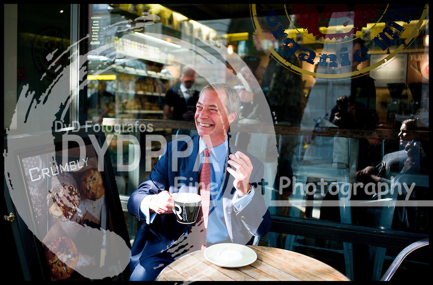 Ukip Leader Nigel Farage having a coffee and a cigarette in Westminster, London, United Kingdom. Thursday, 29th August 2013. Picture by Andrew Parsons / i-Images/ DyD Fotografos