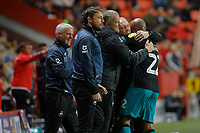 Andre Ayew of Swansea City (R) celebrates his goal with Swansea City manager Steve Cooper and other coaches during the Sky Bet Championship match between Charlton Athletic and Swansea City at The Valley, London, England, UK. Wednesday 02 October 2019