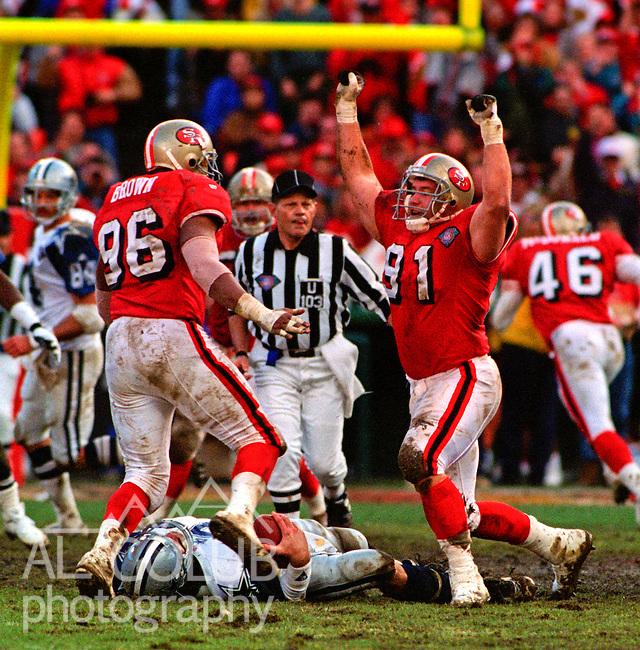 San Francisco 49ers vs. Dallas Cowboys at Candlestick Park Sunday, January 15, 1995.  49ers beat Cowboys 38-28.  San Francisco 49ers defensive end Dennis Brown (96) and defensive tackle Rhett Hall (91) celebrate Dallas Cowboys quarterback Troy Aikman (8) sack.