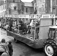 The St. Patrick's Day Parade makes its way down High Street and onto Main Street in 1978. Photo shows the TUF shoes float..Picture by Don MacMonagle.www.macmonagle.com