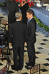 White House Chief of Staff Rahm Emanuel and Treasury Secretary nominee Timothy Geithner stand together and talk as their wives stand nearby following Barack Obama's swearing in as the 44th President of the United States at the luncheon at Statuary Hall in the U.S. Capitol in Washington, DC on January 20, 2009.