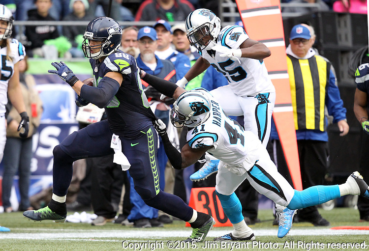 Carolina Panthers  safety Roman Harper (41) grabs Seattle Seahawks tight end Jimmy Graham after he taught a 45-yard pass from Russell Wilson at CenturyLink Field in Seattle on October 18, 2015. The Panthers came from behind with 32 seconds remaining in the 4th Quarter to beat the Seahawks 27-23.  ©2015 Jim Bryant Photography. All Rights Reserved.