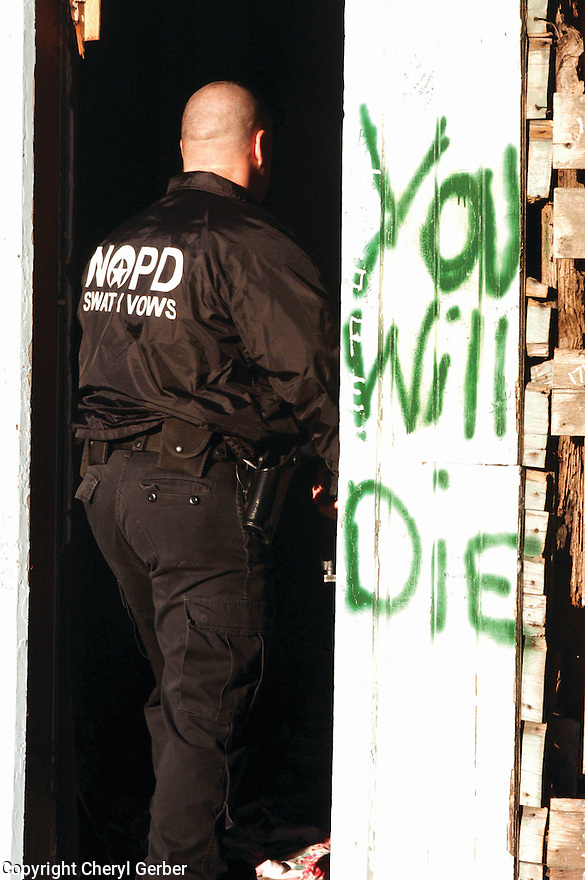 """You Will Die"" graffiti at murder scene in Central City, 2004"