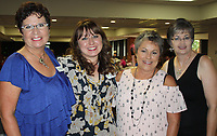 NWA Democrat-Gazette/CARIN SCHOPPMEYER Kim Nelson, Sprouting Hope luncheon chairwoman (from left), Rachel Cox, Debbie Main and Karilea Magee gather at the Healing Gardens benefit luncheon Sept. 28 at the Center for Nonprofits at St. Mary's in Rogers.