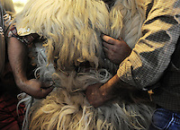 "A ""Joaldun"" gets ready on January 27, 2014 at the village of Ituren, Basque Country. Joaldun groups perform an ancient traditional carnival at the villages of Ituren and Zubieta during two days, carrying sheep furs and big cowbells in their backs and making sound them in order to wake up the earth, to ask for a good new year, a good harvest and also to keep away the bad spirits. (Ander Gillenea / Bostok Photo)"