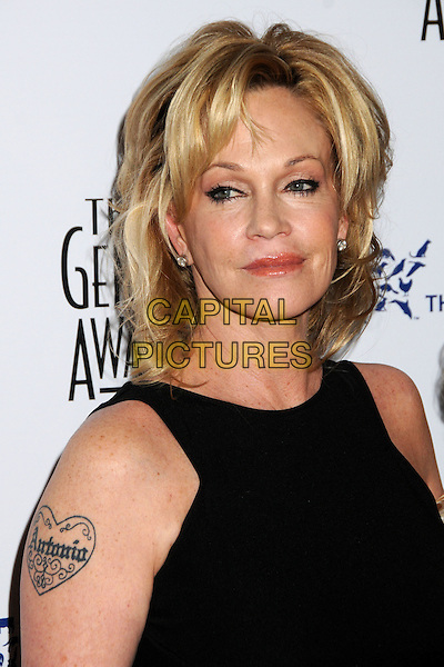 MELANIE GRIFFITH .24th Annual Genesis Awards - Arrivals held at the Beverly Hilton Hotel, Beverly Hills, California, USA, 20th March 2010..portrait headshot black sleeveless stud diamond earrings  Antonio heart name husband tattoo .CAP/ADM/BP.©Byron Purvis/AdMedia/Capital Pictures.