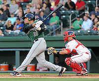 Outfielder Chuckie Jones (20) of the Augusta GreenJackets, a San Francisco Giants affiliate, in a game against the Greenville Drive on April 19, 2012, at Fluor Field at the West End in Greenville, South Carolina. (Tom Priddy/Four Seam Images)