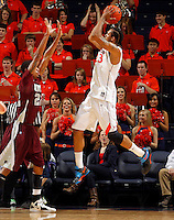 CHARLOTTESVILLE, VA- December 27: Mike Scott #23 of the Virginia Cavaliers shoots the ball over Ron Spencer #22 of the Maryland-Eastern Shore Hawks during the game on December 27, 2011 at the John Paul Jones Arena in Charlottesville, Va. Virginia defeated Maryland Eastern Shore 69-42.  (Photo by Andrew Shurtleff/Getty Images) *** Local Caption *** Ron Spencer