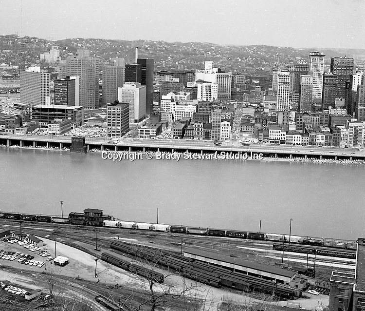 Pittsburgh PA:  View of the city's skyline - 1962.  View includes Gateway Center and construction of the Pittsburgh Press Building.  View also includes the P&LERR railroad yard on the South Side and the many businesses along Fort Pitt Boulevard.